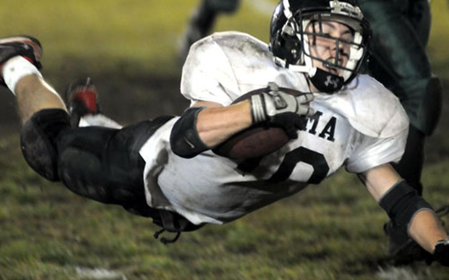 Zama American running back Ashton Norwood goes airborne for yards against Robert D. Edgren during Friday's game at Misawa Air Base, Japan. Zama won 12-7 and captured its first Far East Class A title-game berth.
