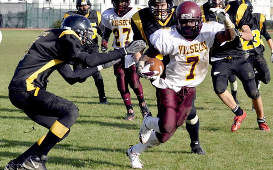 Vilseck running back Angelo Anderson jukes around a would-be Patch tackler during a 17-yard touchdown run during the Falcons' 47-14 win. Anderson scored five touchdowns during the game, three in a 2½-minute stretch in the fourth quarter.