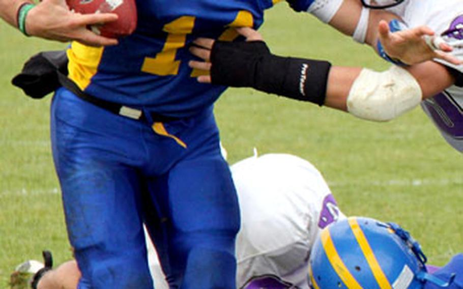 Ansbach quarterback Dominic Barrale fends off a Mannheim tackler and picks up yardage during Ansbach's 44-6 win Saturday. Barrale ran for one touchdown and a two-point conversion, and passed for two TDs and a two-point conversion.