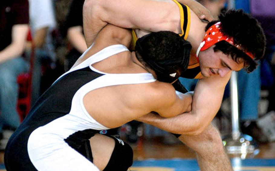 """Kadena's Harry Bloom, right, and Zama American's Elias Labrador compete during the 148-pound gold-medal bout in the 2009 DODDS-Pacific Far East Wrestling Tournament at Camp Foster, Okinawa. Bloom and Labrador's rivalry, like some others over the years, began at the Nile C. Kinnick Invitational """"Beast of the Far East."""""""