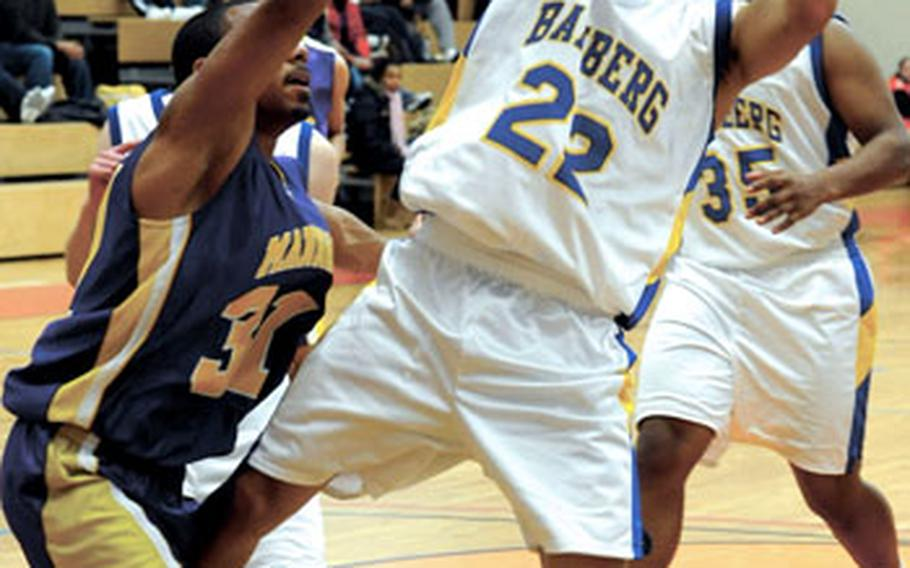Bamberg's Danny Kieser looks for a shot over Mannheim's Jeremy Rodney in Bamberg's 52-37 victory over the Bison in Mannheim on Saturday.