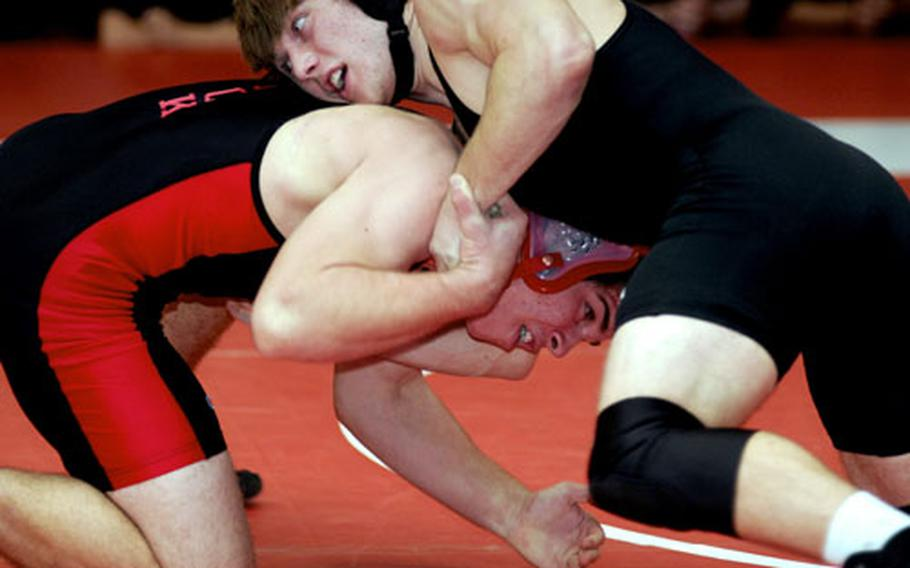 Michael Spencer of Zama American gets the upper hand on Nick Gibbons of Nile C. Kinnick during Saturday's 168-pound gold-medal bout. Spencer decisioned Gibbons 2-0.