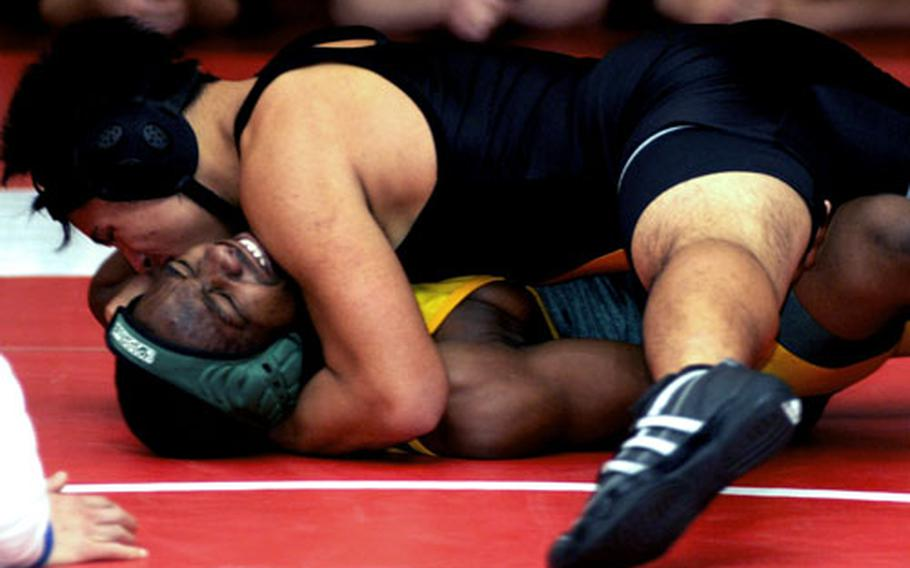 Cody Reyes of Kadena puts the squeeze on Darrel Roberson of Robert D. Edgren during Saturday's 148-pound gold-medal bout. Reyes pinned Roberson in 1 minute, 15 seconds.
