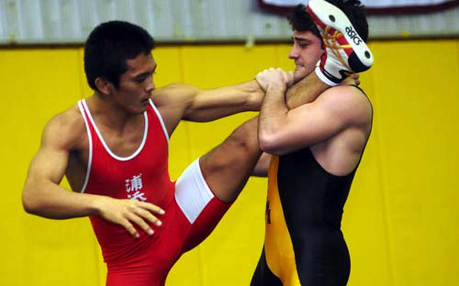 Kadena's Harry Bloom, right, gets Tatsushi Miyagi of Urasoe Industrial up on one leg during the 158-pound bout in Saturday's 4th Okinawa-American Friendship Wrestling Tournament at Panther Pit, Kadena High School, Kadena Air Base, Okinawa. Bloom lost a two-period decision to Miyagi, who won the weight class; Bloom beat Miyagi for the 148-pound title last year.