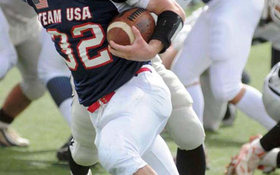 Team USA running back Michael Spencer of Zama American skirts left end for a big gain against Team Kanagawa during Sunday's Camellia Bowl exhibition football game at Kawasaki Stadium, Kawasaki, Japan. Spencer earned MVP honors with 175 yards and three touchdowns on 11 carries in a 61-0 victory.