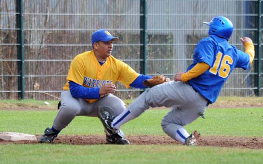 Wiesbaden third baseman Anthony Brown, left, puts the tag on Bamberg's Kevinn Asahan as he attempts to steal third. Wiesbaden won the game, the first of a season-opening doubleheader, 10-7 on Saturday.