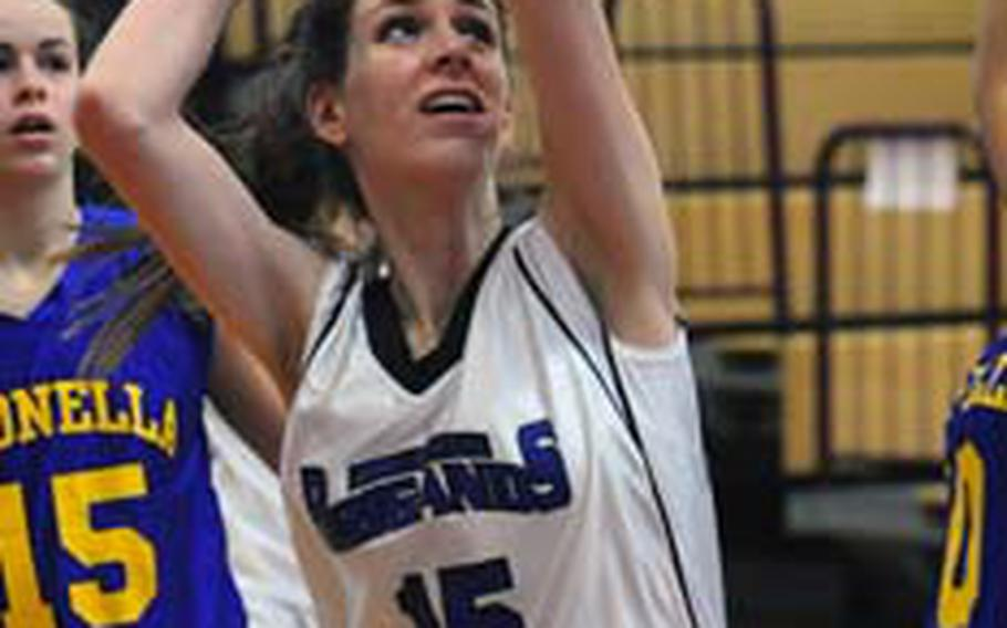 Brussels' Kathleen Anderson aims for the basket in Division III action at the DODDS-Europe basketball championship tournament. The senior was named to the girls All-Europe basketball first team