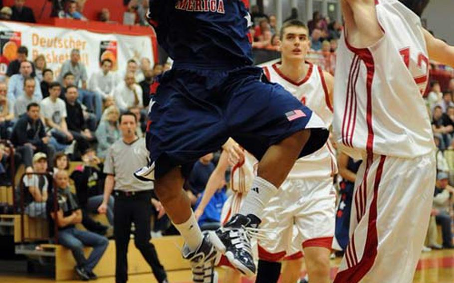 Ryan Boatright of the United States, left, goes to the basket against Croatia's Marko Ramljak late in the game at the Albert Schweitzer tournament in Mannheim, Germany, Saturday night. The United States beat Croatia 71-69 in their first game of the tourney.