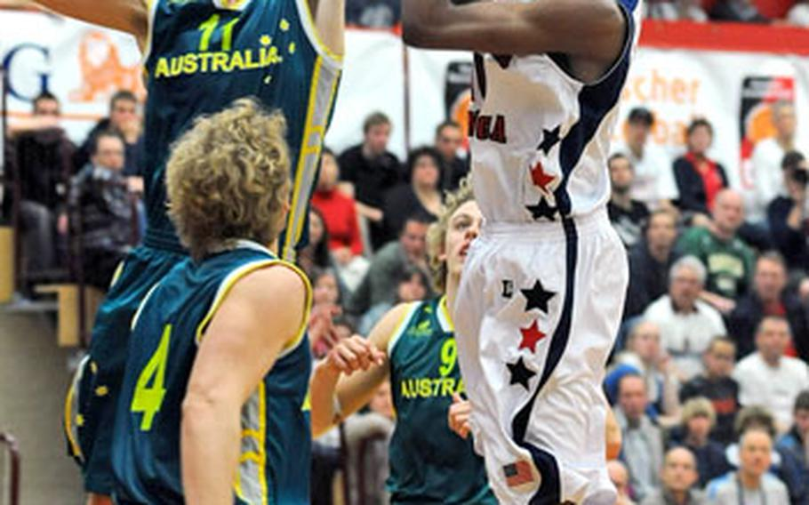 Australia's Mitchell Creek, left, goes high to block a shot by Kevin Ware of the U.S. Creek led the Australians with 23 points, while Ware had eight.