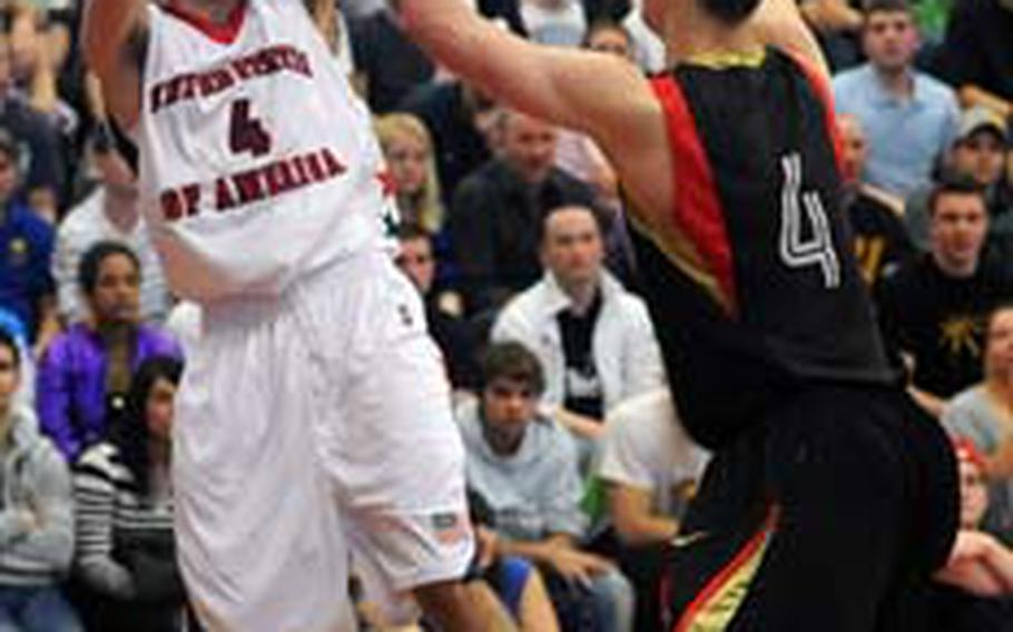 The United States' Dillon Wadsack, a senior at Ramstein High School, looks to pass to an open teammate as Germany's Anselm Hartmann defends. The U.S. lost to Germany's Under-17 team 79-68 in the third place game of the Albert Schweitzer International Youth tournament in Mannheim, Germany, on Saturday.