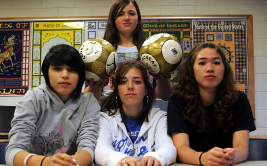 Osan American Cougars strikers Angela Frisby, left, and Stephanie McDole, right, midfielder Courtney Ouellette, center, and goalkeeper Deanna Polaski, standing.