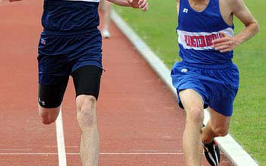 Ramstein's Carl Lewenhaupt, right, beats Heidelberg's Jacob Brainerd to the finish line in a close 3,000-meter race. Lewenhaupt won in 9 minutes, 52.12 seconds, with Brainerd crossing in 9:52.52.