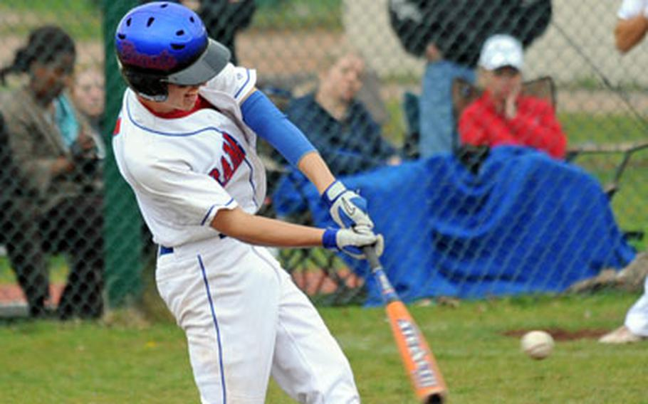 Ramstein's Matt McDonald connects with a run-scoring sacrifice fly that went to the fence in the Royals' 8-5 victory over SHAPE at home on Saturday.