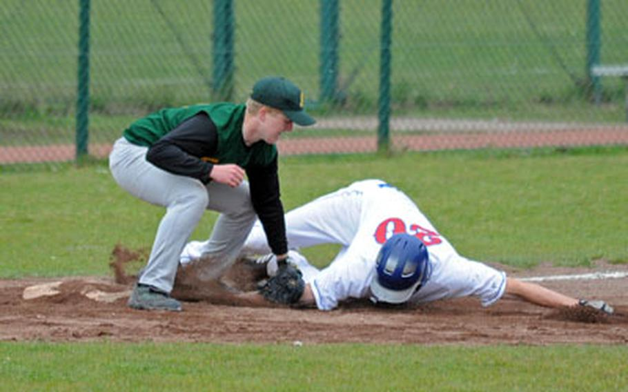 Ramstein's Josh Sloan, right, can't get low enough to escape the tag by SHAPE's Joe Broughton in the first game of a doubleheader in Ramstein, on Saturday. Ramstein won the game 8-5.
