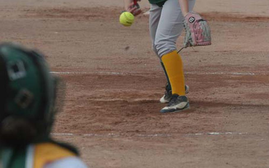 Tasha Matthews, a senior at Alconbury high school, delivers a fastball during the first game of a doubleheader between the Dragons and Lakenheath at RAF Lakenheath. Alconbury dropped both games 18-1 abd 24-2.