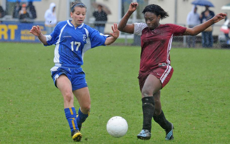 Wiesbaden's Celina Ponte, left, and Vilseck's Josie Rodriguez fight for the ball in the season-opener for both teams on March 27. Both teams are in the same Division I  pool and will meet Wednesday, opening day for the 2010 DODDS-Europe soccer championships.