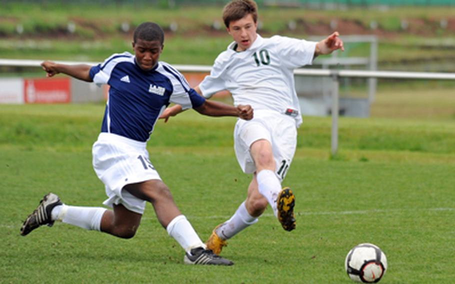 Alconbury's Ernestas Tyminas, right, gets a shot off past the defense of Lajes' Brinson Satterwhite in a boys Division III opening-day match at the DODDS-Europe soccertournament in Kaiserslautern, Germany, on Thursday. Alconbury won 7-0.