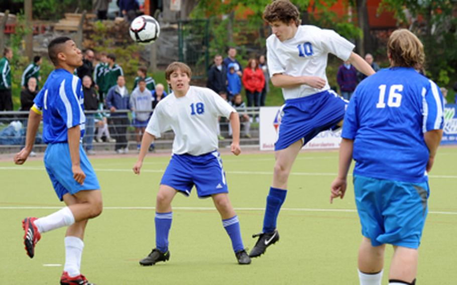 Jack Ulsh of Brussels, second from right, sends a header towards the goal that Incirlik's Marcus White, left, was able to block. Patrick Williams, right, and Aidan McGraw watch the action in Brussels' 7-1 win on opening day of Division II action at the DODDS-Europe soccer championships.   Michael Abrams/Stars and Stripes