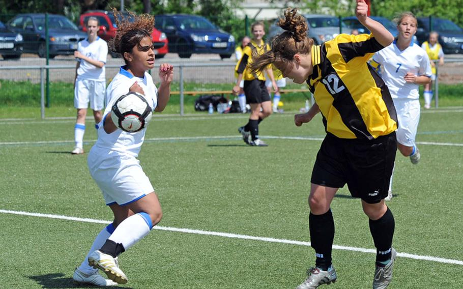 Patch's Emma Murray heads the ball past Ramstein's Italia Rivera in Patch's semifinal win over Ramstein in the DODDS-Europe girls Division I soccer tournament on Friday. Murray scored four goals in an 8-1 win.