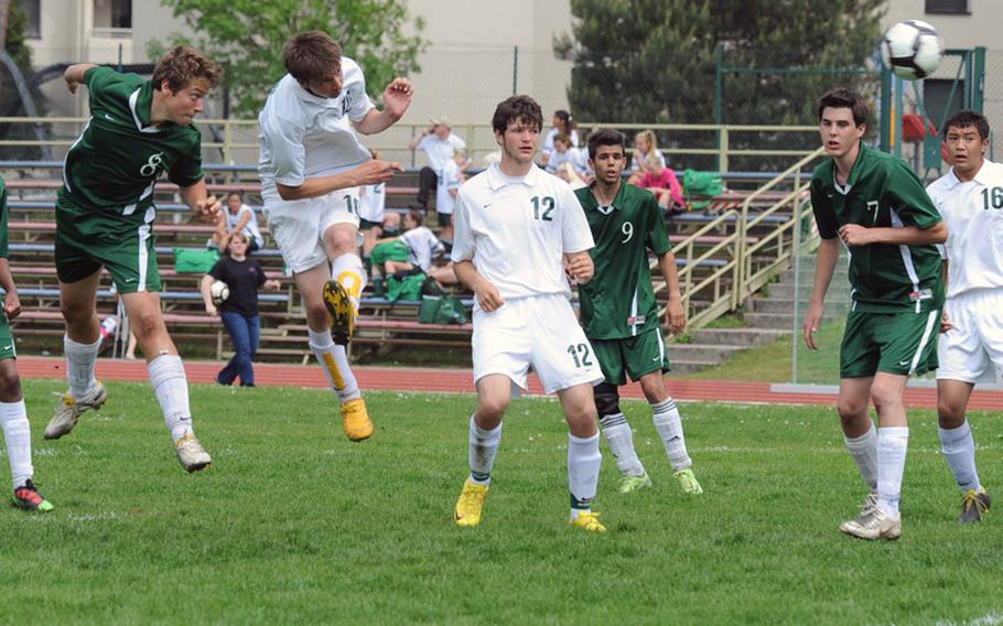 Ankara's Luca Santini, left, watches his header fly toward the net for the  final score in Ankara's  Division III title game victory  against Alconbury. Alconbury's Ernestas Tyminas, second from left, tries to block the shot as Matt Hauser, Illias Kalpogiannakis, Pablo Marin Gomez and Kerry Kuheana, from left, watch. Santini scored three goals in the 4-2 victory.