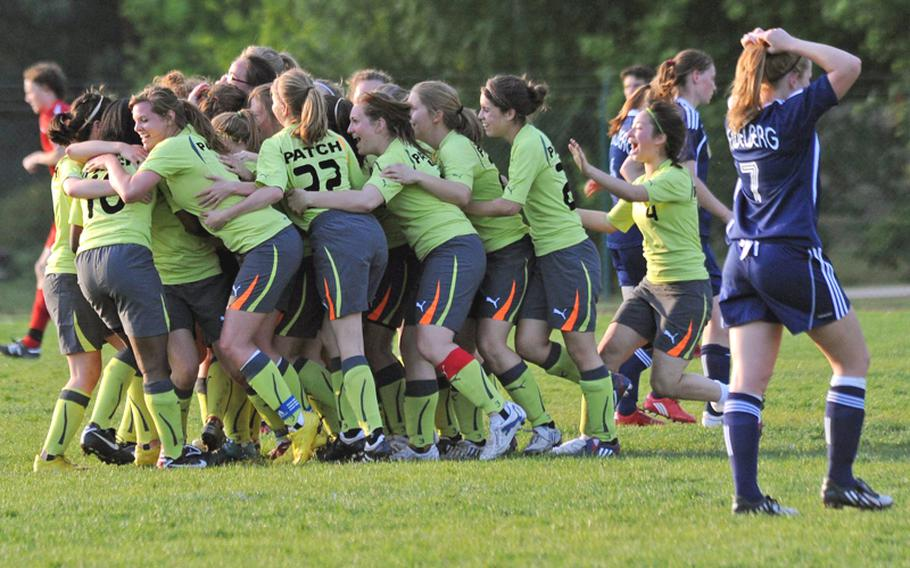 The Patch Lady Panthers celebrate their 2-1 overtime win against Heidelberg in the Division I final at the DODDS-Europe soccer finals in Ramstein on Saturday. Nelly Loney scored the winning goal