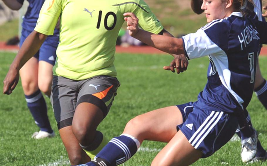 Heidelberg's Maggie Cutler, right, clears the ball in front of Patch's Nelly Loney. Loney later scored the winning goal in Patch's 2-1 overtime victory in the Division I final at the DODDS-Europe soccer tournament on Saturday.