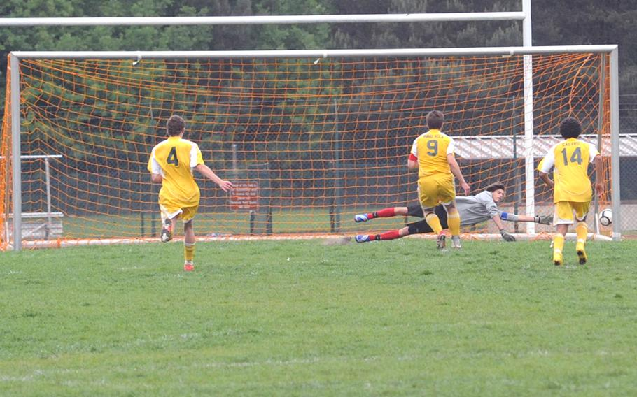 International School of Belgium's goalie Pierre Koob can't reach the 1-0 penalty kick by SHAPE's Manuel Vela in the first half of the Division I title game at the DODDS-Europe soccer championships in Ramstein, Germany, on Saturday night. SHAPE took the crown with a 2-0 win over their Belgian rivals.