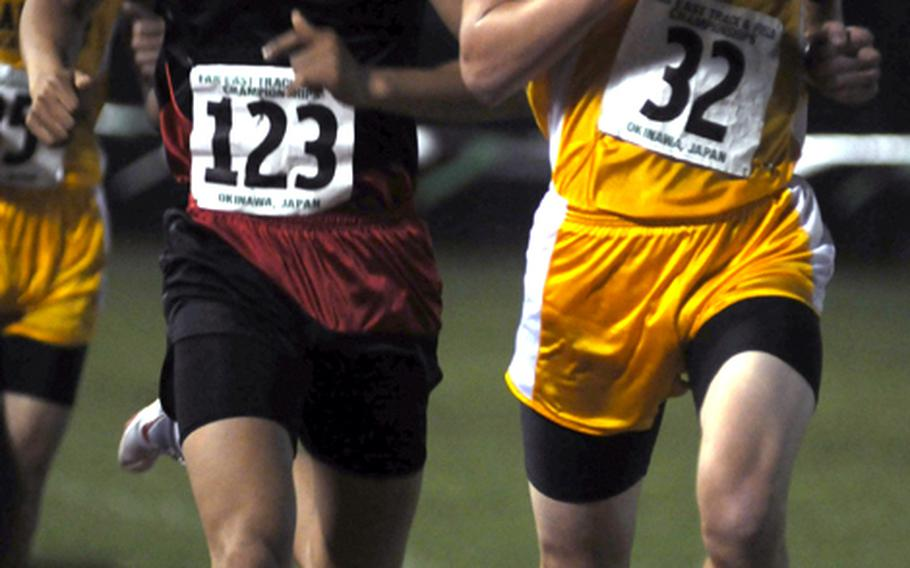 May 24, 2010 Kadena's Jacob Bishop (32) and Seoul American's Thomas Kim (123) lead the pack during the 3,000-meter run on Day 1 Monday in the 2010 DODEA Pacific Far East High School Track & Field Championships at Mike Petty Stadium, Kubasaki High School, Camp Foster, Okinawa. Kim dashed past Bishop on the last lap and beat him 9:17.58-9:21.25.