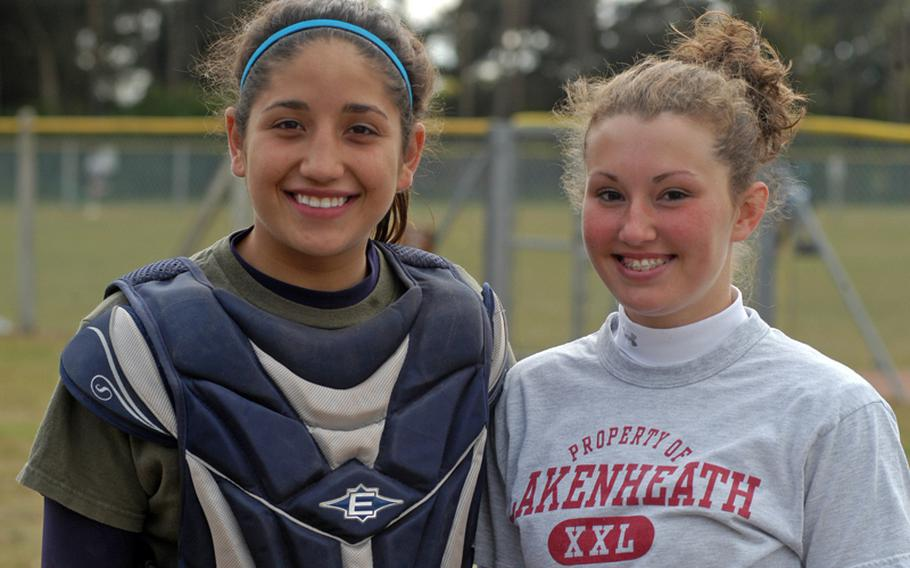 Seniors Nicole McBride, left, and Ali Parkerson have played varsity softball together since they were freshmen. This year they are co-captains, following in the footsteps of their sisters who were also team captains at Lakenheath.