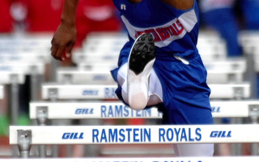 Ramstein's Dimitri Mobley clears a hurdle on his way to winning the 110-meter race during a track meet earlier this year in Ramstein. Mobley also runs the 300 meter hurdles, and is the only person this year to break the 40-second mark in that event.