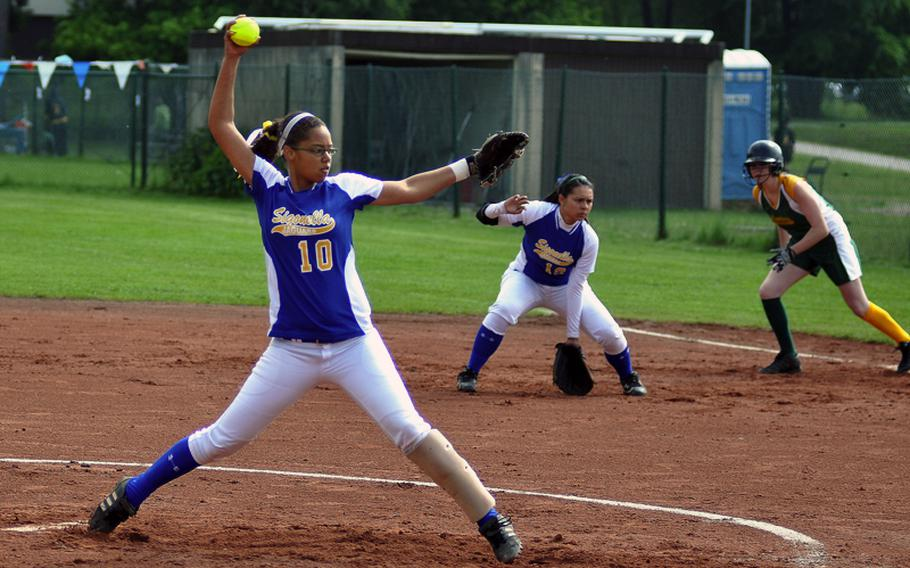 Sigonella pitcher Mekayla Valentine fires a pitch as Alconbury's Ashley Steele takes off on a successful steal attempt during the DODDS-Europe Division III softball game on Friday at Ramstein Air Base, Germany. Top-seeded Sigonella beat No. 2 seed Alconbury 14-11.