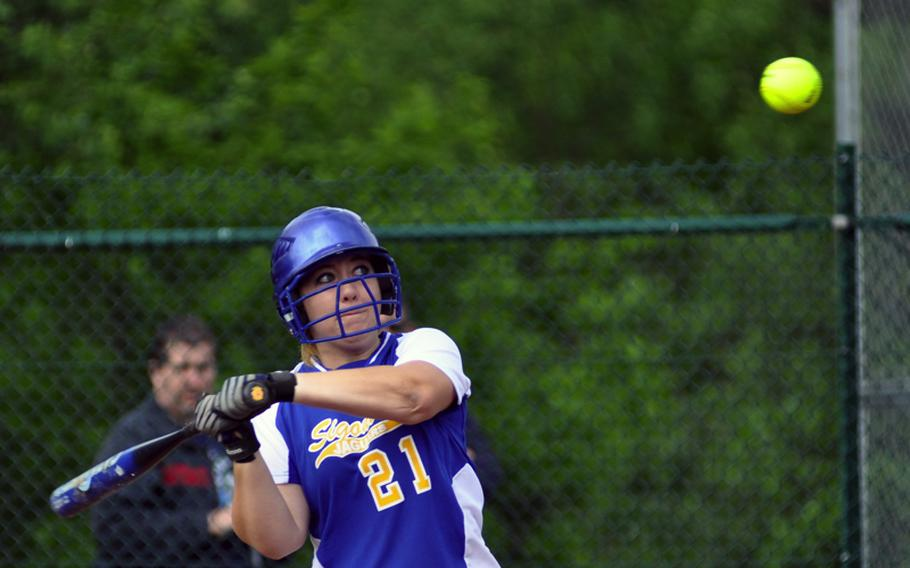 Sigonella's Lizz Adams swings and misses at a high pitch during the bottom of the second inning of a DODDS-Europe Division III softball game Friday at Ramstein Air Base, Germany. Sigonella went on to win the game 14-11.