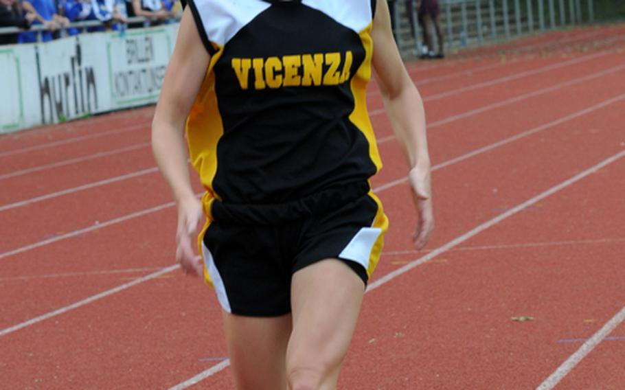 Vicenza's Penny Boswell is all by herself, leading the field by about a half lap, in winning the girls 3,000-meter run in 10 minutes, 49.38 seconds on the first day of the DODDS-Europe Track and Field Championships at the Rüsselsheim, Germany,  stadium. Second was Elizabeth Doe of Ramstein  in 11:16.47. Third was Ashley Santos of Kaiserslautern in 11:18.92.