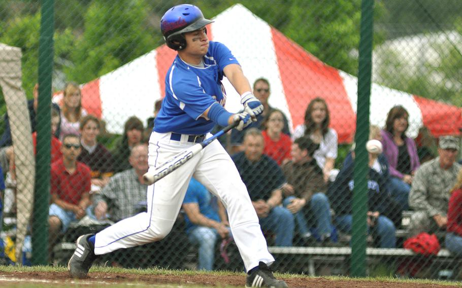 Ramstein left outfielder Shawn Madl hits a single to right field against SHAPE during the top of the first inning in the Division I baseball tournament game Friday at Ramstein Air Base, Germany. Ramstein won 24-5.