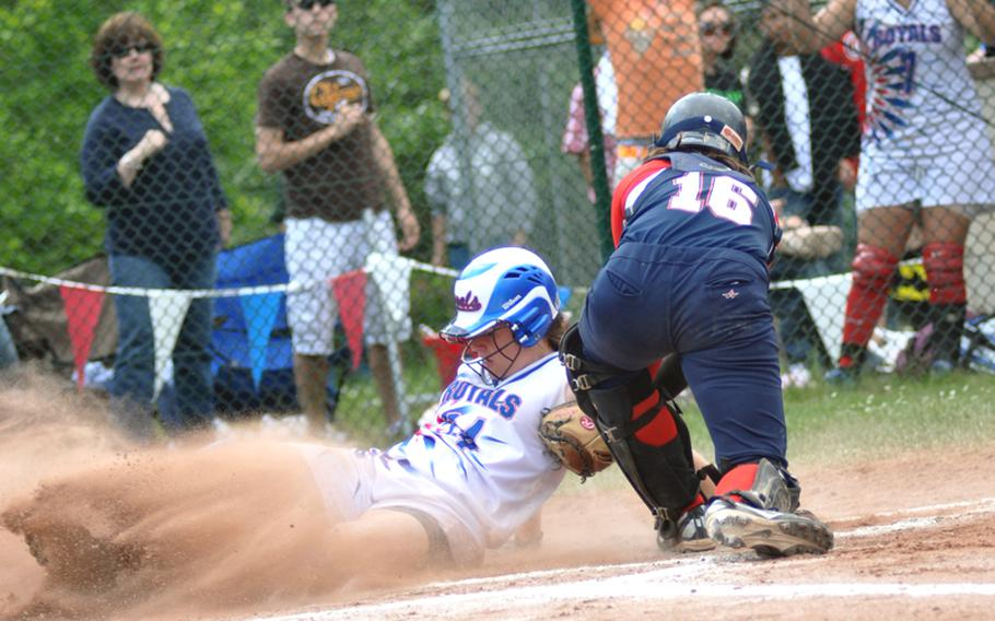 Ramstein's Kayla Pahls slides home safely past Lakenheath catcher Nicole McBride during the DODDS-Europe Division I softball championship game at Ramstein High School on Saturday. Ramstein won, 5-1.