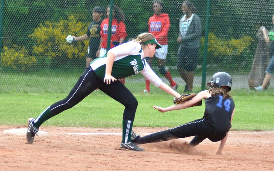 Naples third baseman Alley Ward tags out Hohenfels' Casey Leon during the DODDS-Europe Division II softball championship game at Ramstein High School on Saturday. Naples won, 6-0.