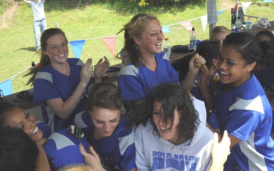 Rota's dugout explodes with excitement after a 16-12 win over Incirlik in the DODDS-Europe Division III championship game at Ramstein High School.