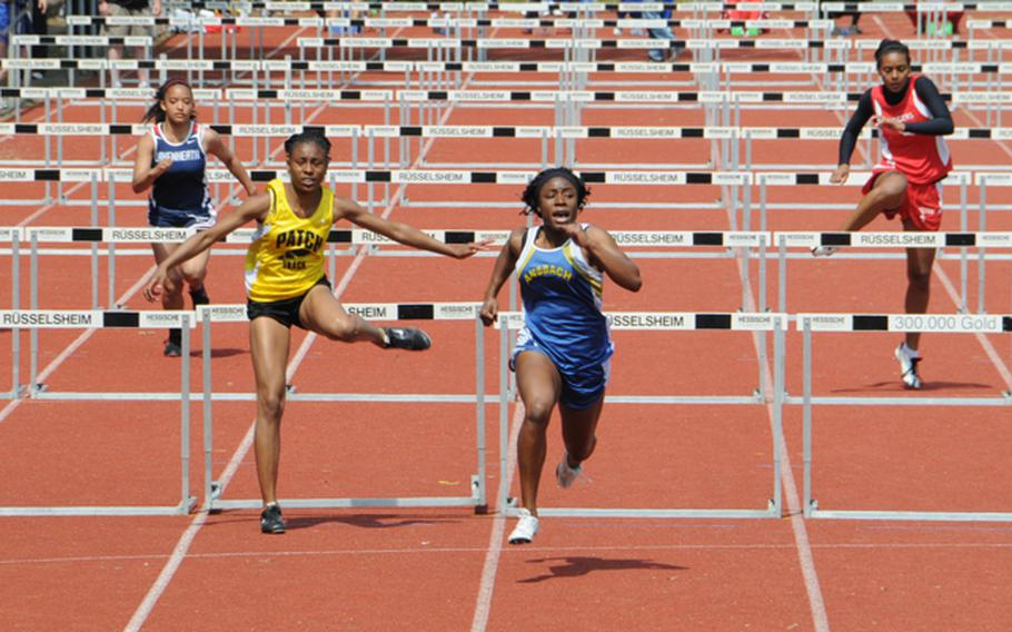 Tiffany Heard of Ansbach High wins her second gold medal of the DODDS-Europe Track and Field Champions by taking the girls 100 meter hurdles in DODDS-Europe record time of 14.81 seconds. Second was Shy Kimeyun Alexander of Patch at 15.23, and third was Tatjana Gainey of Kaiserslautern at 17.35.