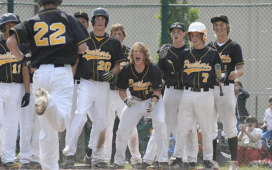 Players from Patch greet junior Cavan Cohoes after he hit a two-run home run to tie the game 8-8 during the European Division I high school baseball championship game at Ramstein Air Base on Saturday. Patch went on to defeat Ramstein 10-9.