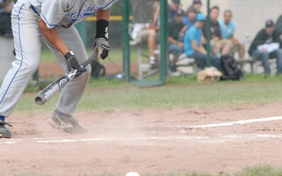 Rota senior Alan Genido fouls a bunt attempt during the DII/III championship game of the European high school baseball championships on Saturday.