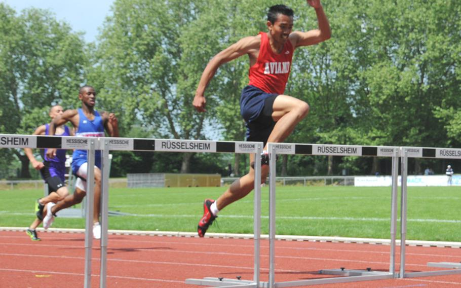 Francis Ledesma of Aviano High, on the way to winning the boys 300 meter hurdles in 40.09 seconds. Dimitri Mobley of Ramstein finished second in 40.60; Trey Darby of Baumholder was third in 40.71.