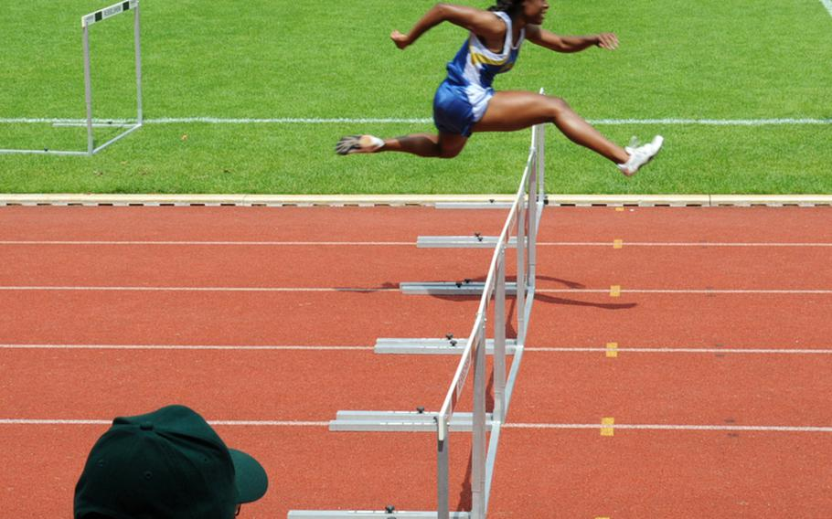 Tiffany Heard wins her third gold medal with a victory in the girls 300 meter hurdles at the 2010 DODDS-Europe Track and Field Championships. Her time of 45.69 was more than three seconds better than the runner-up.
