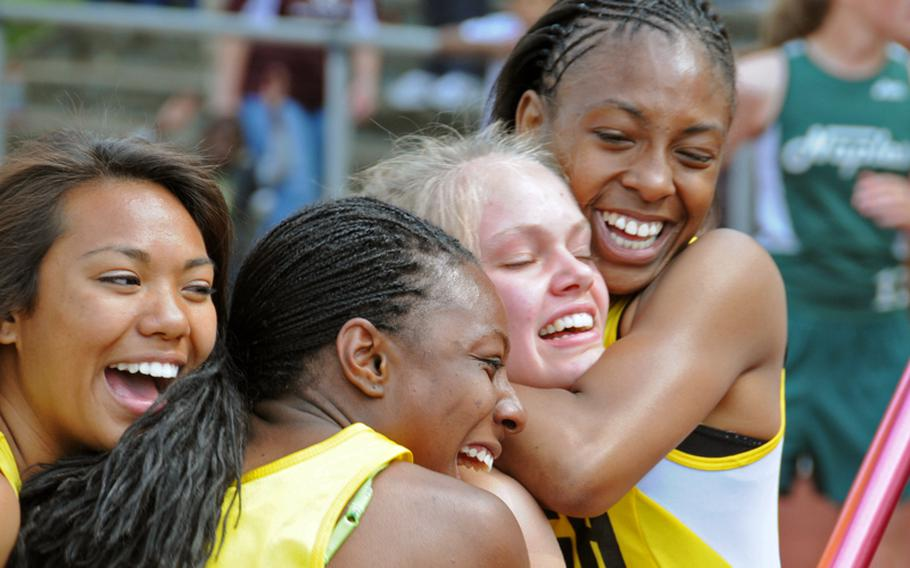 The Patch girls 1,600 sprint medley team celebrates its victory in the the DODDS-Europe Track and Field Championships on Saturday. From left are Abby Diaz, Kristin Robinson, Cass Bush (who ran the final leg) and Shy Alexander, who won in 4:23.48. Vilseck was second in in 4:25.9 and Naples third in 4:28.90.