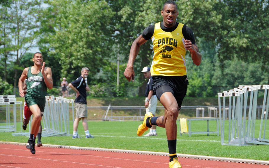 Julius Johnson-Rich of Patch wins his second gold, in the boys 400 meter, in 49.83 seconds. The runner-up was Derrick Flake of Ansbach in 51.11, and third place went to Sean Outing of Aviano in 51.55.
