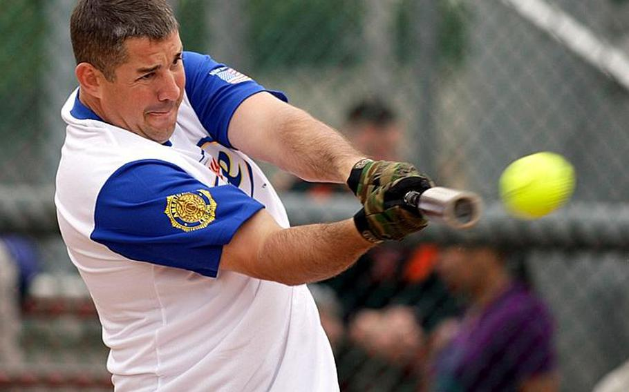 Former All-Air Force infielder Gary Lafon takes his cuts on a Scrapalators pitch during Monday's men's championship game in the 20th Pacificwide Open Interservice Softball Tournament at Field 1, Lombardo Field FourPlex, South Post, Yongsan Garrison, South Korea. Legion repeated its title, beating Scrapalators 26-13 in five innings.
