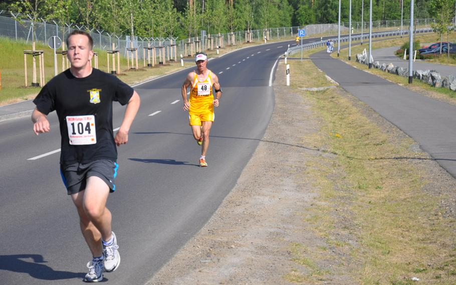Gregory Mularz of Grafenwöhr leads William Smith of Stuttgart at the nine-mile mark of the U.S. Forces-Europe Army 10-Miler Qualifier on Saturday. Smith ended up passing Mularz as the two civilians finished the race in around 70 minutes.
