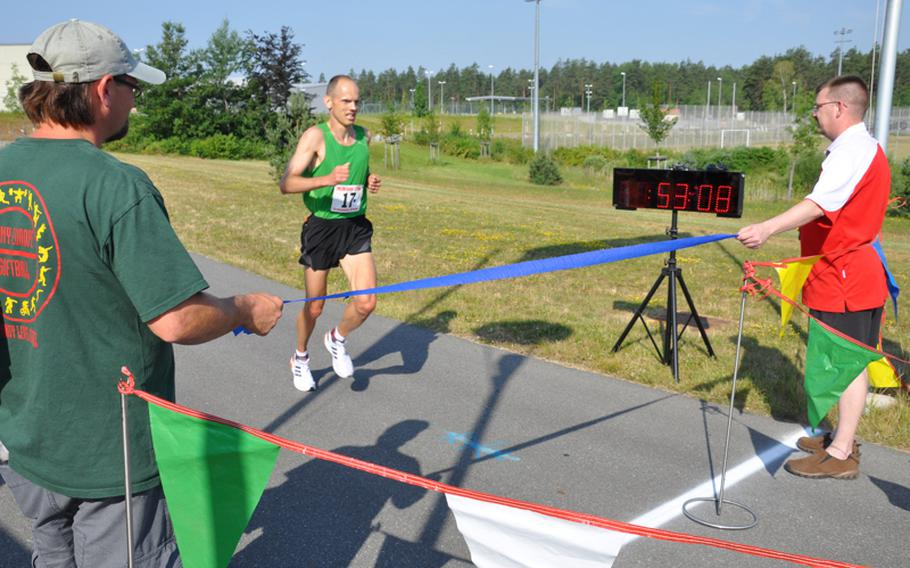 Maj. Keith Matiskella of Grafenwöhr nears the finish line of the U.S. Forces-Europe Army 10-Miler in record time. He finished in 53 minutes, 9 seconds to lead qualifiers for the Army 10-Miler in October.