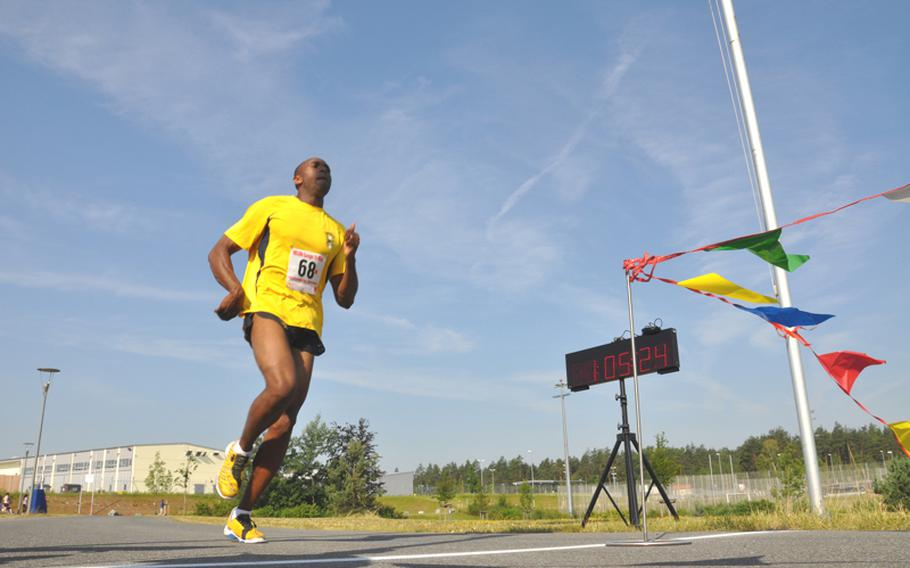 Capt. Adolph Dubose, 30, of Vicenza, Italy,  crosses the finish line of the U.S. Forces-Europe Army 10-Miler Qualifier race on Saturday. He finished fifth among male soldiers and qualified for the Army 10-Miler in October.