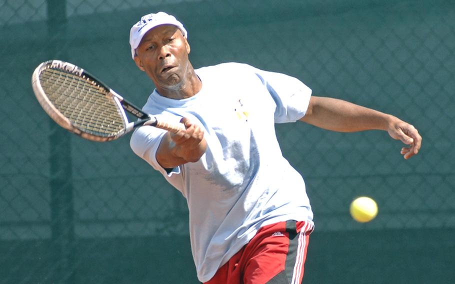 Terry Johnson sends a forehand back over the net in his men's open division final against Jorge Sepulveda at the U.S. Forces Europe tennis championships in Heidelberg, Germany, on Sunday. Johnson beat his doubles partner 6-3, 6-4.