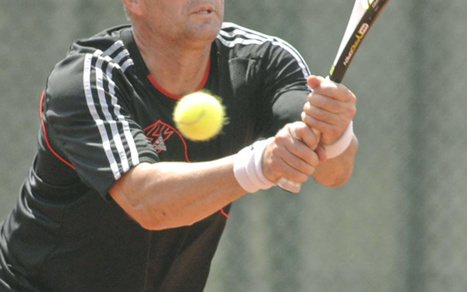 Metin Karaca returns a shot by Ralph Totorica in the men's masters final at the 2010 U.S. Forces Europe tennis championships in Heidelberg, Germany, on Sunday. Karaca won the match 2-6, 6-3, 6-1.
